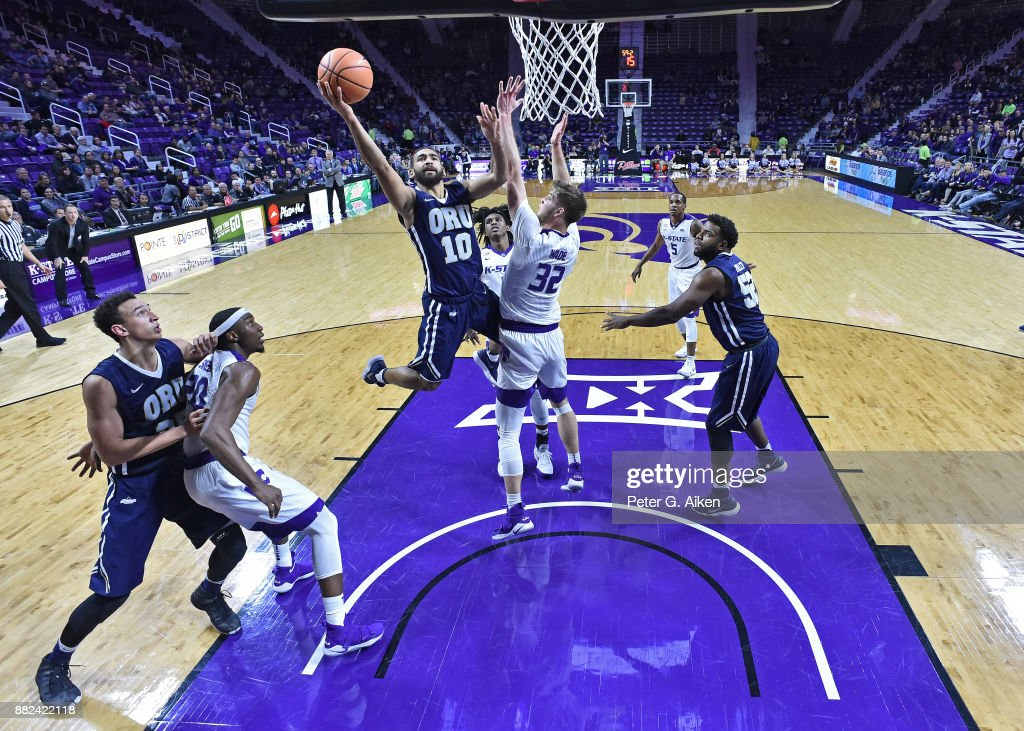 Guard Sam Kearns #10 of the Oral Roberts Golden Eagles drives to the basket against forward Dean Wade #32 of the Kansas State Wildcats during the second half on November 29, 2017 at Bramlage Coliseum in Manhattan, Kansas.