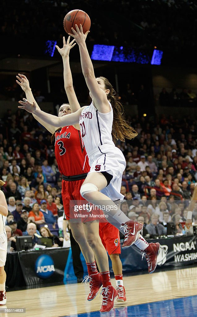 Guard Sara James #21 of the Stanford Cardinal goes to the hoop while guard/forward Anne Marie Armstrong #3 of the Georgia Lady Bulldogs defends in the second half during the NCAA Division I Women's Basketball Regional Championship at Spokane Arena on March 30, 2013 in Spokane, Washington. The Lady Bulldogs defeated the Cardinal 61-59.