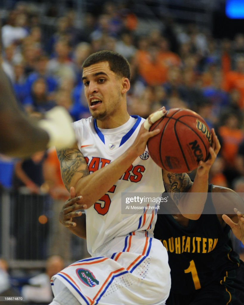 Guard Scottie Wilbekin #5 of the Florida Gators drives for a basket against the Southeastern Louisiana Lions December 19, 2012 at Stephen C. O'Connell Center in Gainesville, Florida. The Gators won 82 - 43.