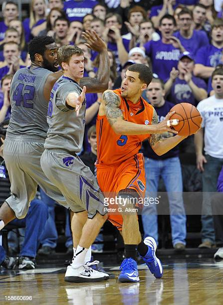 Guard Scottie Wilbekin of the Florida Gators looks to make a pass against guard Will Spradling of the Kansas State Wildcats during the first half on...
