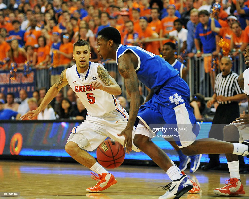 Guard Scottie Wilbekin #5 of the Florida Gators sets on defense against the Kentucky Wildcats February 12, 2013 at Stephen C. O'Connell Center in Gainesville, Florida. Wilbekin scored 14 points and Florida won 69 - 52.