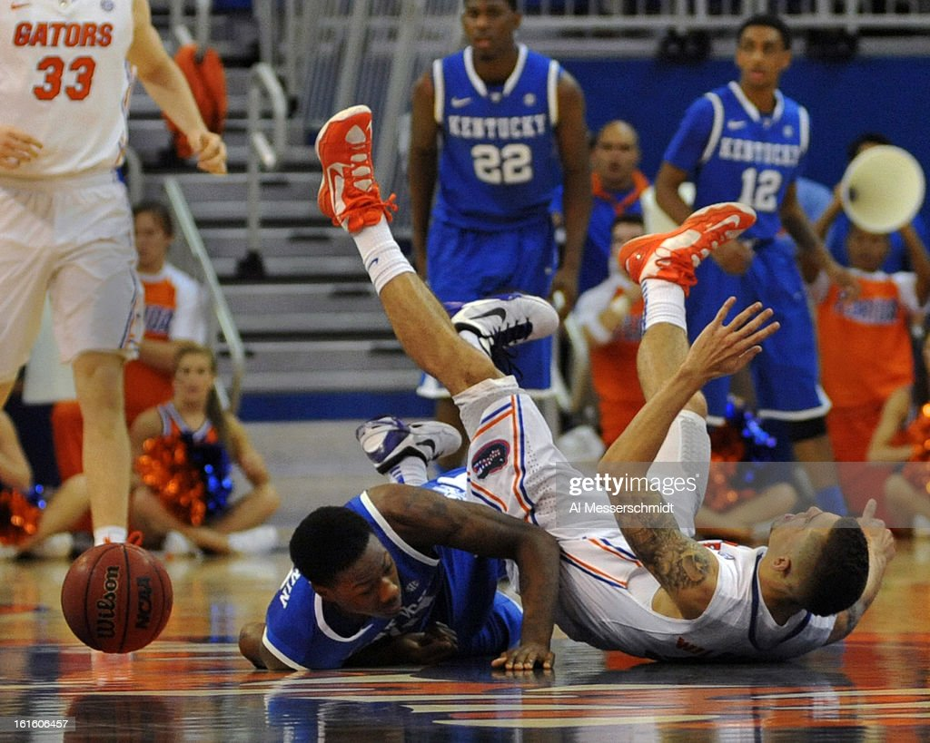 Guard Scottie Wilbekin #5 of the Florida Gators tumbles over guard <a gi-track='captionPersonalityLinkClicked' href=/galleries/search?phrase=Archie+Goodwin&family=editorial&specificpeople=9086088 ng-click='$event.stopPropagation()'>Archie Goodwin</a> #10 of the Kentucky Wildcats February 12, 2013 at Stephen C. O'Connell Center in Gainesville, Florida. Wilbekin scored 14 points and Florida won 69 - 52.