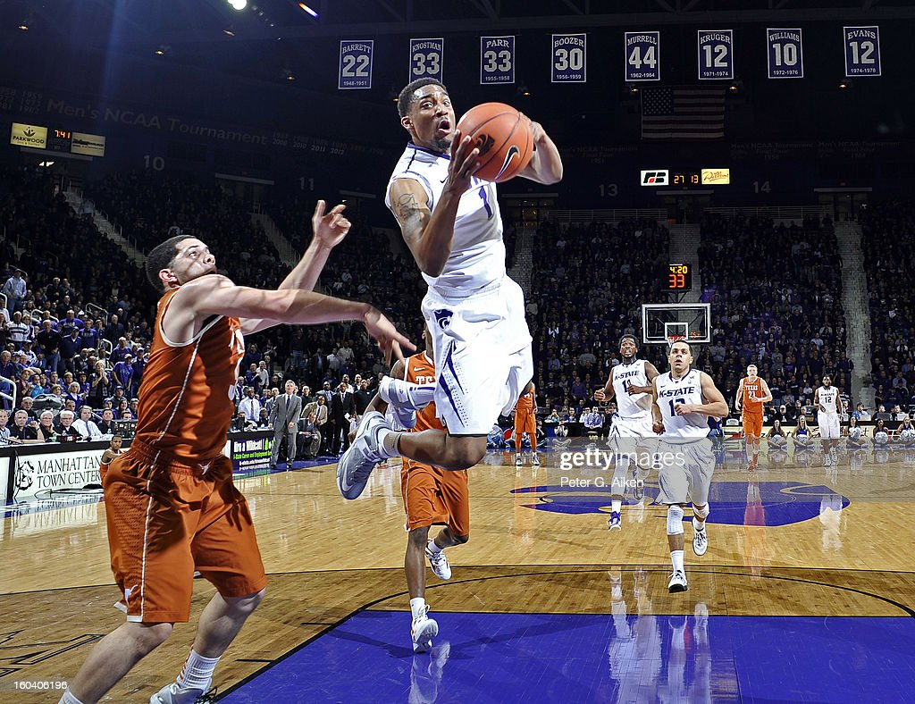 Guard Shane Southwell #1 of the Kansas State Wildcats drives to the basket past guard Javan Felix #3 of the Texas Longhorns during the first half on January 30, 2013 at Bramlage Coliseum in Manhattan, Kansas. Kansas State defeated Texas 83-57.