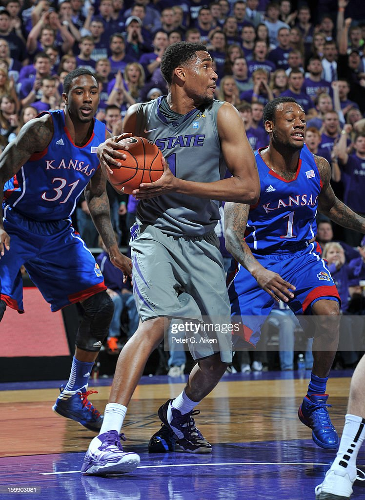 Guard Shane Southwell #1 of the Kansas State Wildcats recovers a loose ball against the Kansas Jayhawks during the first half on January 22, 2013 at Bramlage Coliseum in Manhattan, Kansas. Kansas defeated Kansas State 59-55.
