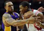 Guard Shannon Brown of the Los Angeles Lakers challenges Kyle Lowry of the Houston Rockets in Game Six of the Western Conference Semifinals during...