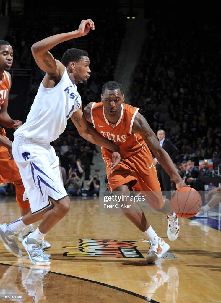 Guard Sheldon McCleallan (R) of the Texas Longhorns drives against guard Shane Southwell (L) of the Kansas State Wildcats during the first half on January 30, 2013 at Bramlage Coliseum in Manhattan, Kansas.