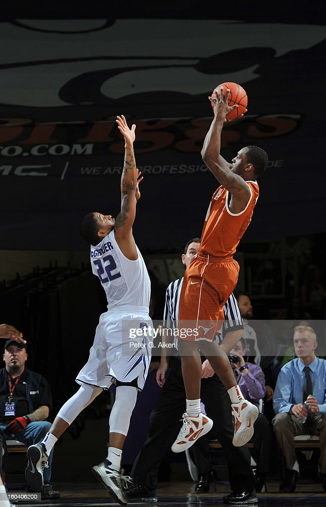 Guard Sheldon McClellan #1 of the Texas Longhorns puts up a shot against guard Rodney McGruder #22 of the Kansas State Wildcats during the second half on January 30, 2013 at Bramlage Coliseum in Manhattan, Kansas. Kansas State defeated Texas 83-57.
