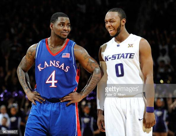 Guard Sherron Collins of the Kansas Jayhawks shares a laugh with guard Jacob Pullen of the Kansas State Wildcats in the second half on January 30...