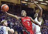 Guard Shy McClelland of the South Dakota Coyotes drives in for a score against forward DJ Johnson of the Kansas State Wildcats during the first half...