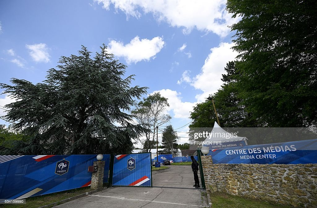 A guard stands at the entrance of the Media Center in Clairefontaine on May 25, 2016, where part of the upcoming Euro 2016 European football championships facilities are. / AFP / FRANCK