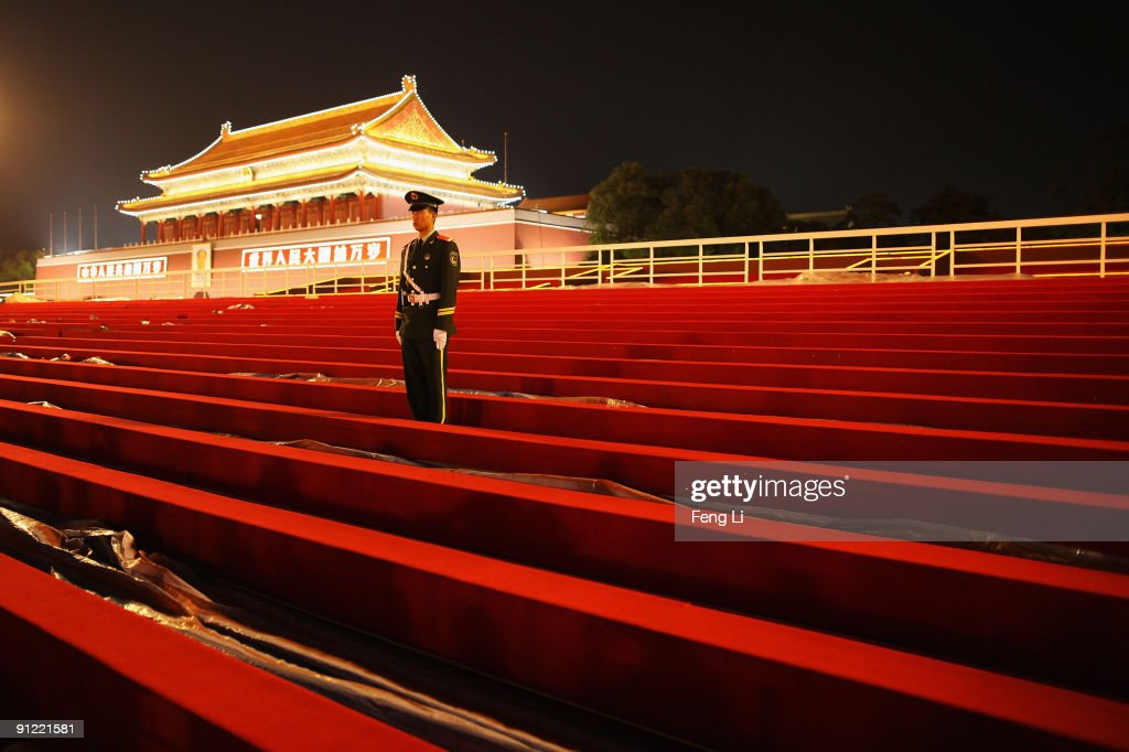 A guard stands on the temporary reviewing stand built for the upcoming National Day celebration on Tiananmen Square on September 28, 2009 in Beijing, China. The grand celebrations to commemorate the 60th anniversary of the founding of the People's Republic of China are set to include a military parade and mass pageant consisting of about 200,000 citizens in Tian'anmen Square on October 1.