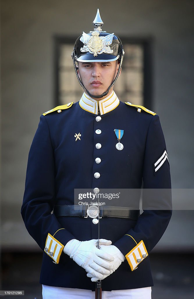 A guard stands outside the Royal Palace as preparations for the wedding of Princess Madeleine of Sweden and Christopher O'Neill continues on June 7, 2013 in Stockholm, Sweden.