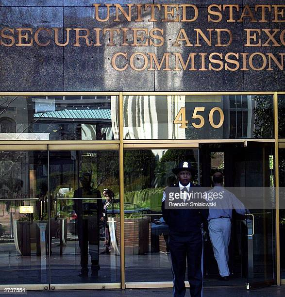 A guard stands outside the US Securities and Exchange Commission November 17 2003 in Washington DC The SEC held a press conference Monday announcing...