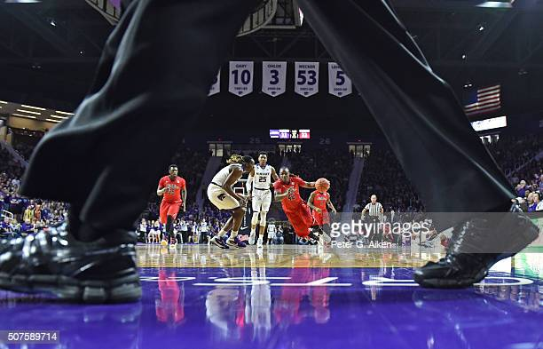 Guard Stefan Moody of the Mississippi Rebels drives with the ball against forward DJ Johnson of the Kansas State Wildcats during the first half on...