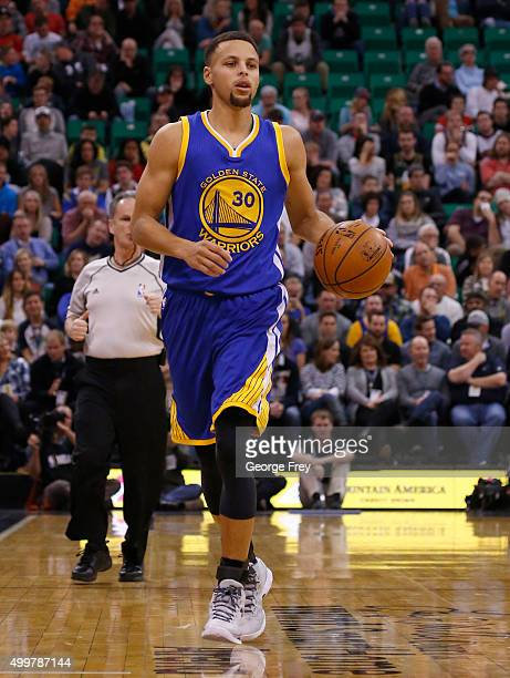 Guard Stephen Curry of the Golden State Warriors brings the ball down court during a game against the Utah Jazz during the first half of an NBA game...