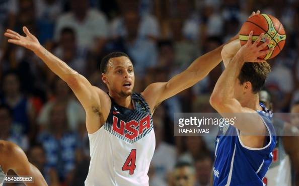 US guard Stephen Curry vies with Finland's guard Petteri Koponen looks at the scoreboard during the 2014 FIBA World basketball championships group C...