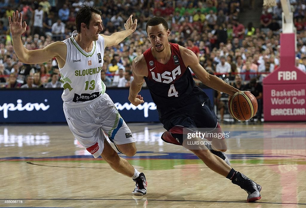US guard <a gi-track='captionPersonalityLinkClicked' href=/galleries/search?phrase=Stephen+Curry+-+Basketball+Player&family=editorial&specificpeople=5040623 ng-click='$event.stopPropagation()'>Stephen Curry</a> (R) vies with Slovenia's guard Domen Lorbek (L) during the 2014 FIBA World basketball championships quarter-final match Slovenia vs USA at the Palau Sant Jordi arena in Barcelona on September 9, 2014.