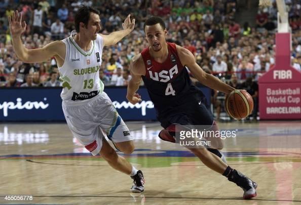 US guard Stephen Curry vies with Slovenia's guard Domen Lorbek during the 2014 FIBA World basketball championships quarterfinal match Slovenia vs USA...