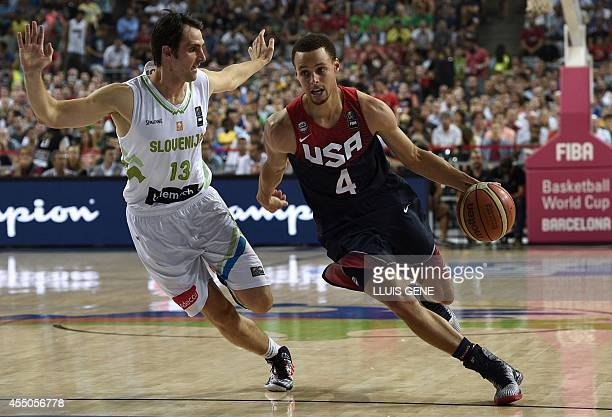 US guard Stephen Curry vies with Slovenia's guard Domen Lorbek during the 2014 FIBA World basketball championships quarterfinal match Slovenia vs USA...