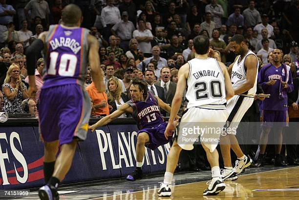 Guard Steve Nash of the Phoenix Suns falls out of bounds after a flagrant foul by Robert Horry of the San Antonio Spurs in Game Four of the Western...