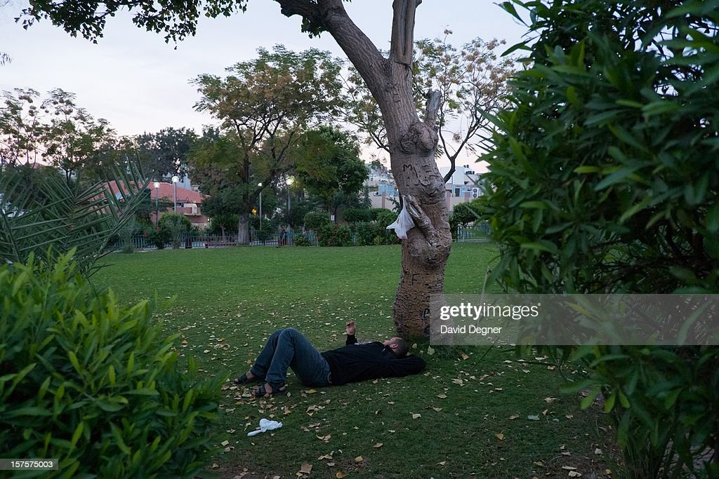 A guard takes a break in the garden behind the Shifa Hospital in Gaza City, Gaza on November 21, 2012. The front of the hospital is filled with constant activity as the wounded and dead are brought to be treated.