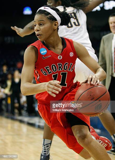 Guard Tiara Griffin of the Georgia Lady Bulldogs moves the ball towards the hoop against the California Golden Bears during the NCAA Division I...