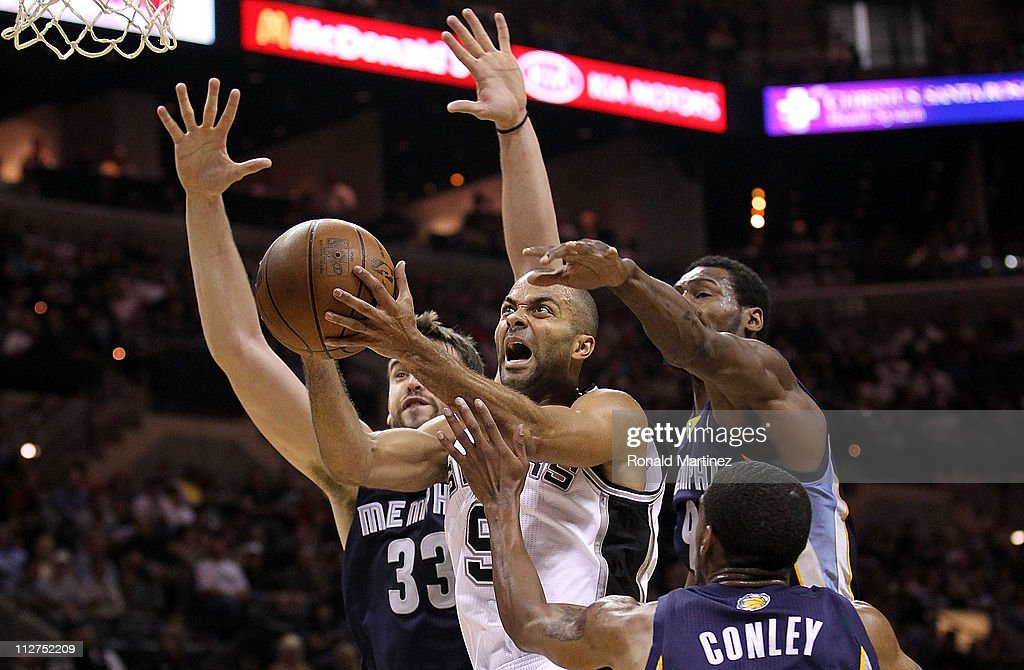 Guard Tony Parker #9 of the San Antonio Spurs takes a shot against <a gi-track='captionPersonalityLinkClicked' href=/galleries/search?phrase=Marc+Gasol&family=editorial&specificpeople=661205 ng-click='$event.stopPropagation()'>Marc Gasol</a> #33, <a gi-track='captionPersonalityLinkClicked' href=/galleries/search?phrase=Tony+Allen+-+Basketball+Player&family=editorial&specificpeople=201665 ng-click='$event.stopPropagation()'>Tony Allen</a> #9 and Mike Conley #11 of the Memphis Grizzlies in Game Two of the Western Conference Quarterfinals in the 2011 NBA Playoffs on April 20, 2011 at AT&T Center in San Antonio, Texas.