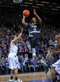 Guard Tony Taylor of the George Washington Colonials drives to the basket past guard Angel Rodriguez of the Kansas State Wildcats during the first...