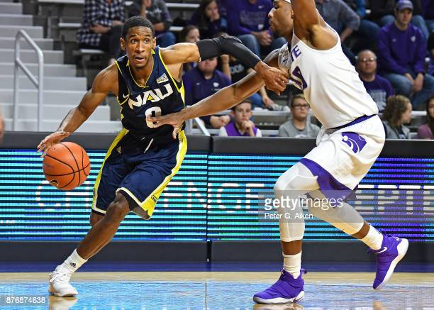 Guard Torry Johnson of the Northern Arizona Lumberjacks dives to the basket against the Kansas State Wildcats during the first half on November 20...