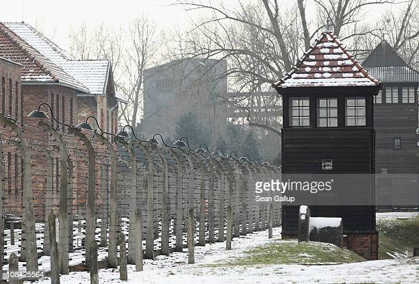 A guard tower stands next to a perimeter fence at the Auschwitz I memorial and former concentration camp on the 66th anniversary of the liberation of...