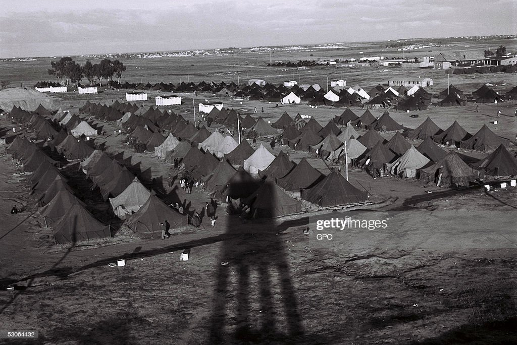A guard tower throws a long afternoon shadow over a new immigrants' camp December 1, 1949 at Beit Lid in the newly-established State of Israel.