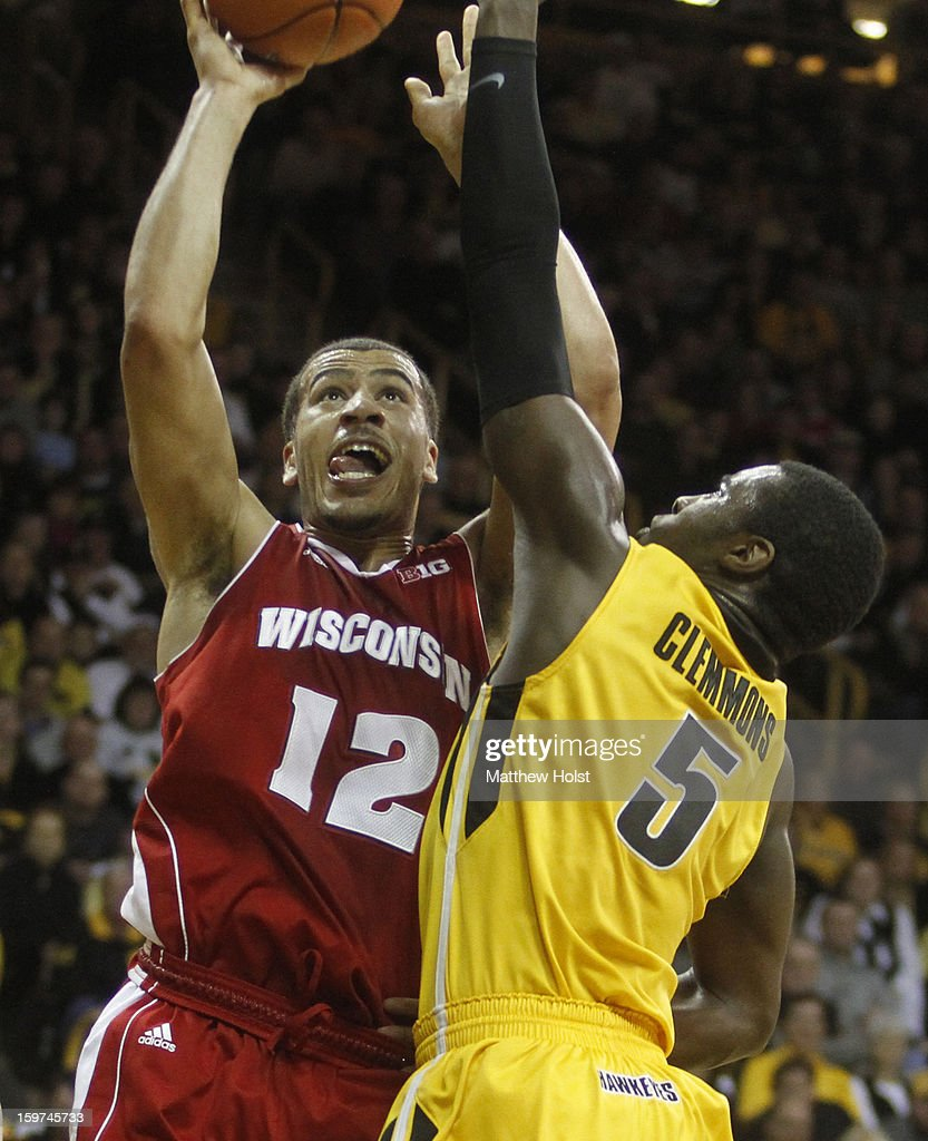 Guard Traevon Jackson #12 of the Wisconsin Badgers drives to the basket during the first half against guard Anthony Clemmons #5 of the Iowa Hawkeyes on January 19, 2013 at Carver-Hawkeye Arena in Iowa City, Iowa. Iowa won 70-66.