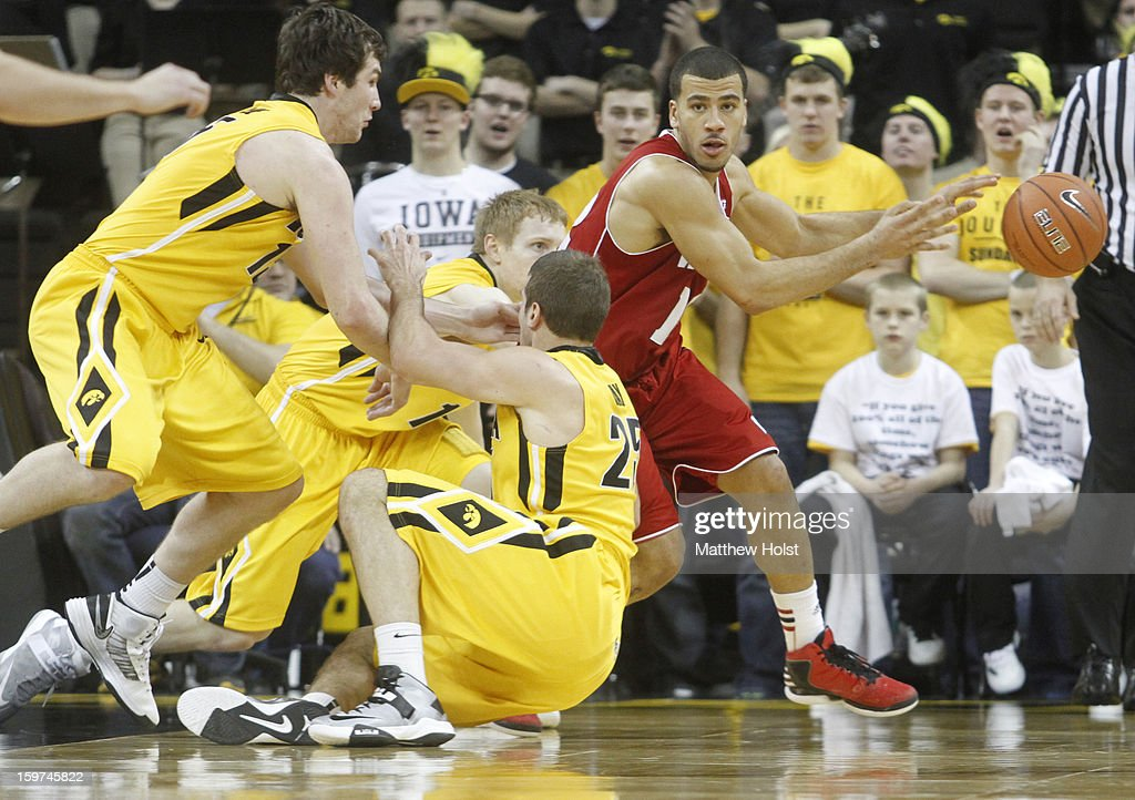 Guard Traevon Jackson #12 of the Wisconsin Badgers passes the ball away during the second half in front of guard Mike Gesell #10, forward Eric May #25 and forward Zah McCabe #15 of the Iowa Hawkeyes on January 19, 2013 at Carver-Hawkeye Arena in Iowa City, Iowa. Iowa won 70-66.