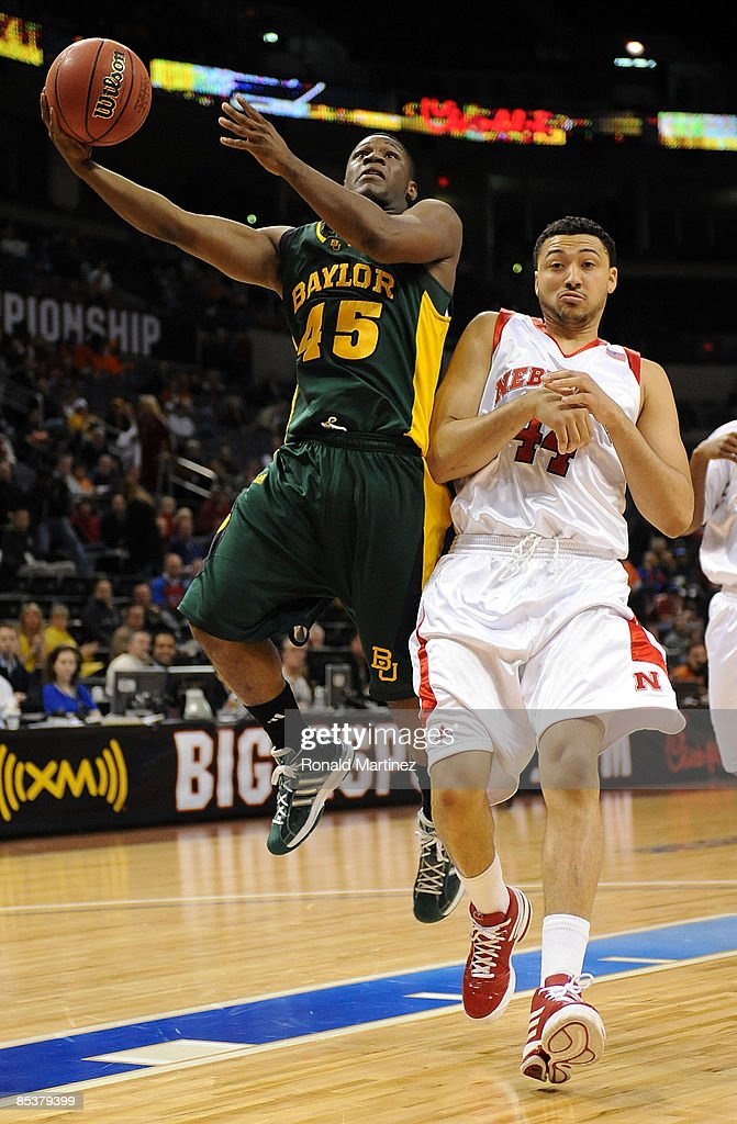 Guard Tweety Carter #45 of the Baylor Bears takes a shot against Ryan Anderson #44 of the Nebraska Cornhuskers during the Phillips 66 Big 12 Men's Basketball Championship at the Ford Center March 11, 2009 in Oklahoma City, Oklahoma.