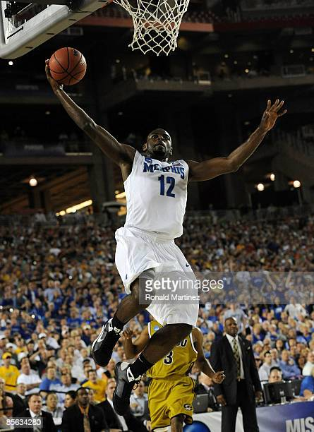 Guard Tyreke Evans of the Memphis Tigers goes to dunk the ball against the Missouri Tigers in the Sweet 16 of the NCAA Division I Men's Basketball...
