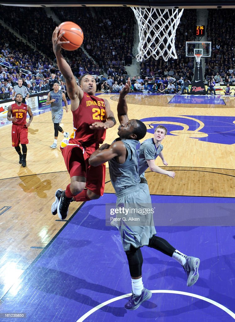 Guard Tyrus McGee #25 of the Iowa State Cyclones drives to the basket against guard Martavious Irving #3 of the Kansas State Wildcats during the second half on February 9, 2013 at Bramlage Coliseum in Manhattan, Kansas. Kansas State defeated Iowa State 79-70.