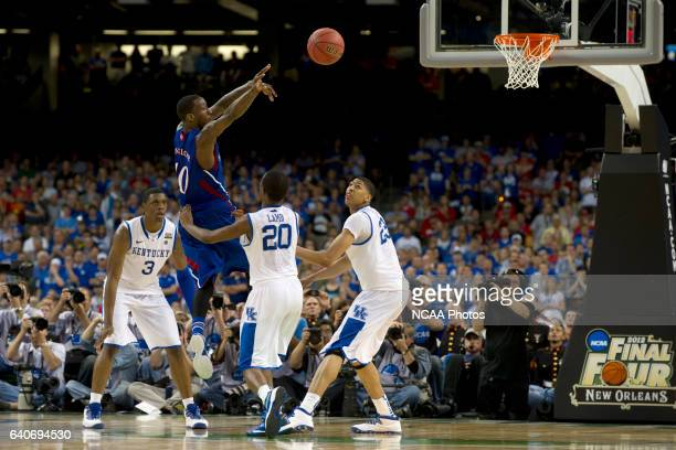 Guard Tyshawn Taylor from the University of Kansas pass the ball to teammate in front of the defense of forward Terrence Jones guard Doron Lamb and...