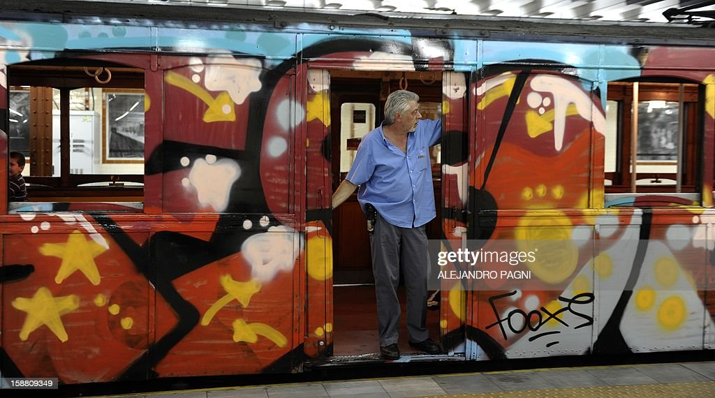 A guard waits for passengers in one of the historic wagons La Brugeoise of subway Line A, which is expected to be close soon following a decision by city mayor Mauricio Macri to replace the fleet with Chinese-made wagons, in Buenos Aires, on December 29, 2012. Line A was the first subway line to work in the southern hemisphere and its trains are among the ten oldest still working daily. The La Brugeoise wagons were constructed between 1912 and 1919 by La Brugeoise et Nicaise et Delcuve in Belgium.