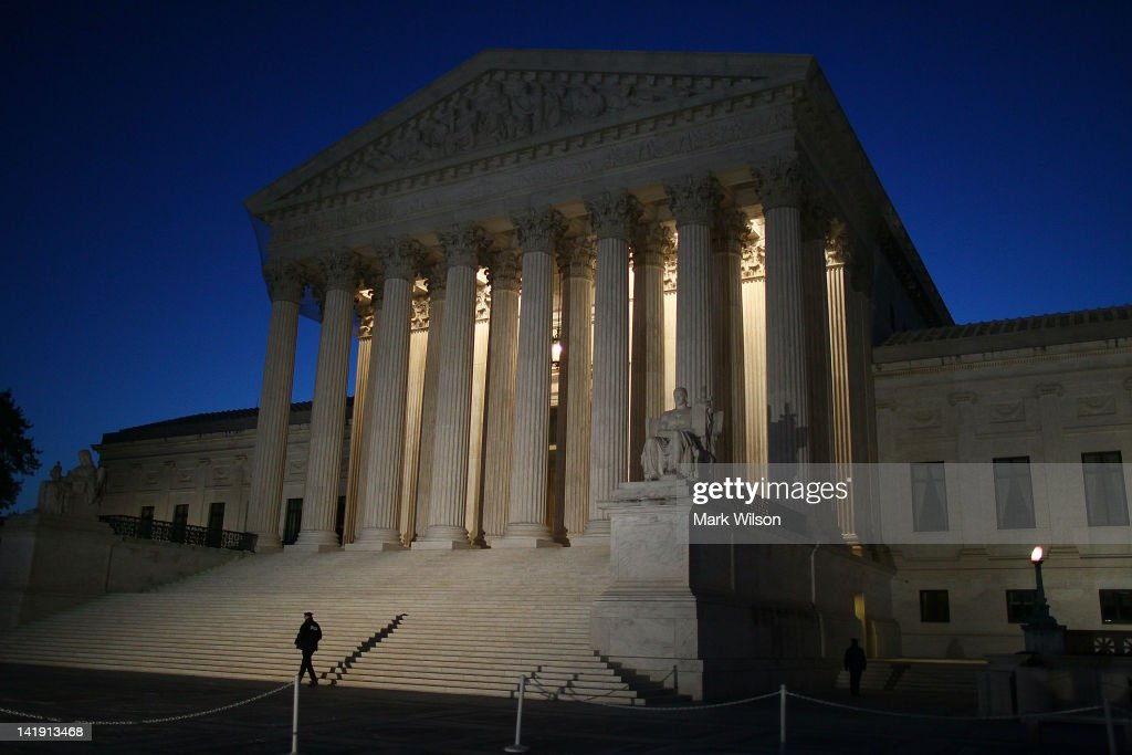 A guard walks outside the U.S. Supreme Court Building on March 26, 2012 in Washington, DC. Today the high court, which has set aside six hours over three days, will hear arguments over the constitutionality President Barack Obama's Patient Protection and Affordable Care Act.