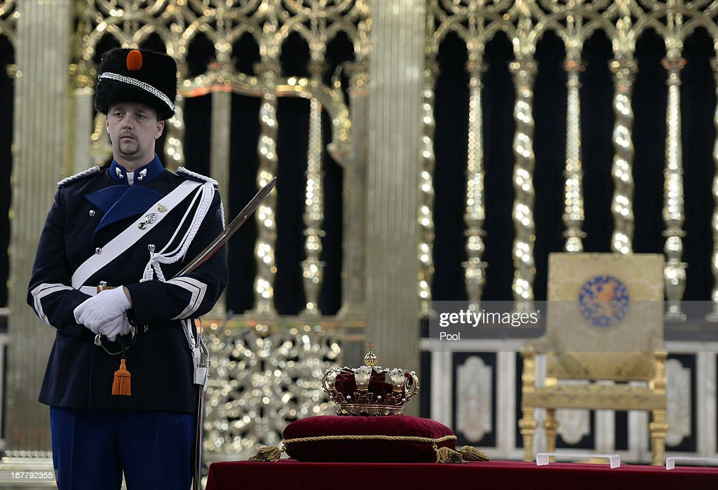A guard watches over the regalia (Crown, Sceptre, Globus Cruciger and Sword of State) at the credence-table prior to the inauguration of HM King Willem Alexander of the Netherlands at New Church on April 30, 2013 in Amsterdam, Netherlands.
