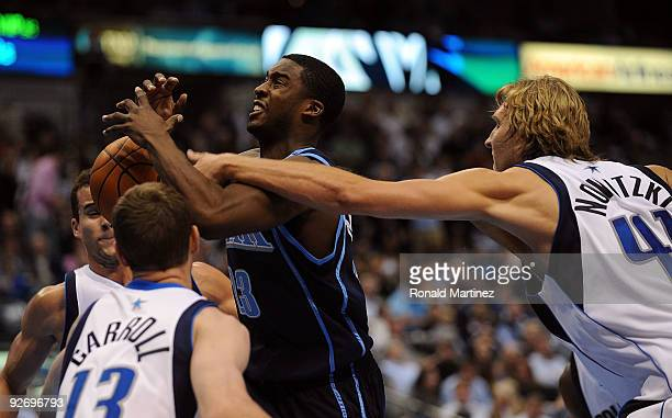 Guard Wes Matthews of the Utah Jazz is fouled by Dirk Nowitzki of the Dallas Mavericks on November 3 2009 at American Airlines Center in Dallas Texas...