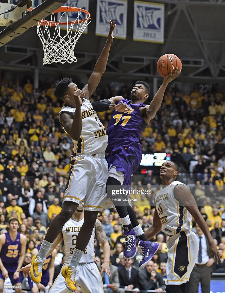 Guard Wes Washpun #11 of the Northern Iowa Panthers drives and scores against forward Zach Brown #1 of the Wichita State Shockers during the second half on February 13, 2016 at Charles Koch Arena in Wichita, Kansas. Northern Iowa defeated Wichita State 53-50.