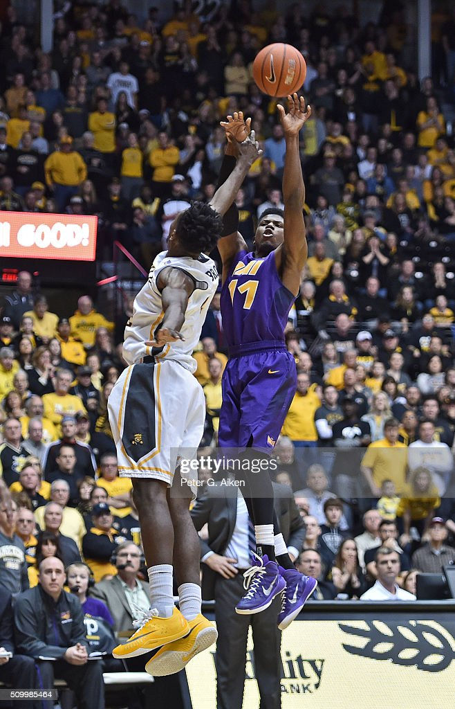 Guard Wes Washpun #11 of the Northern Iowa Panthers puts up a shot against forward Zach Brown #1 of the Wichita State Shockers during the second half on February 13, 2016 at Charles Koch Arena in Wichita, Kansas. Northern Iowa defeated Wichita State 53-50.