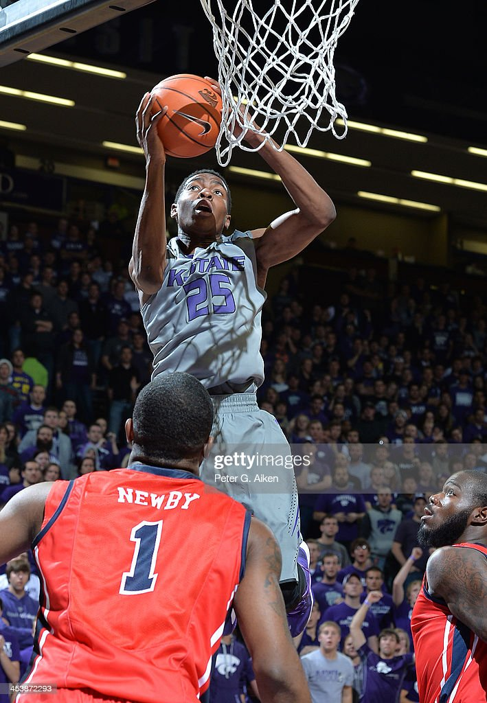 Guard Wesley Iwundu #25 of the Kansas State Wildcats drives in for a basket against guard Martavious Newby #1 of the Mississippi Rebels during the second half on December 5, 2013 at Bramlage Coliseum in Manhattan, Kansas. Kansas State won 61-58.