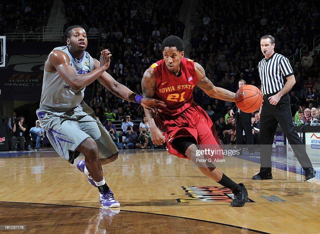 Guard Will Clyburn #21 of the Iowa State Cyclones drives against forward D.J. Johnson #50 of the Kansas State Wildcats during the first half on February 9, 2013 at Bramlage Coliseum in Manhattan, Kansas. Kansas State defeated Iowa State 79-70.