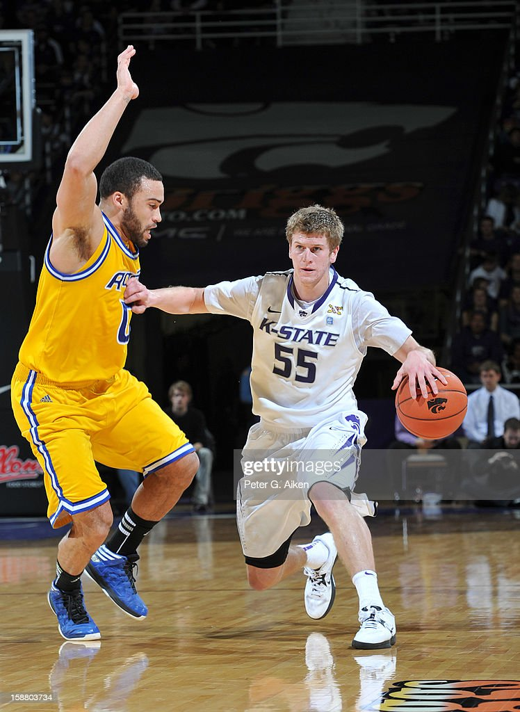 Guard Will Spradling #55 of the Kansas State Wildcats brings the ball up court against guard Nate Rogers #0 of the Missouri-Kansas City Kangaroos during the second half on December 29, 2012 at Bramlage Coliseum in Manhattan, Kansas. Kansas State defeated Missouri-Kansas City 52-44.