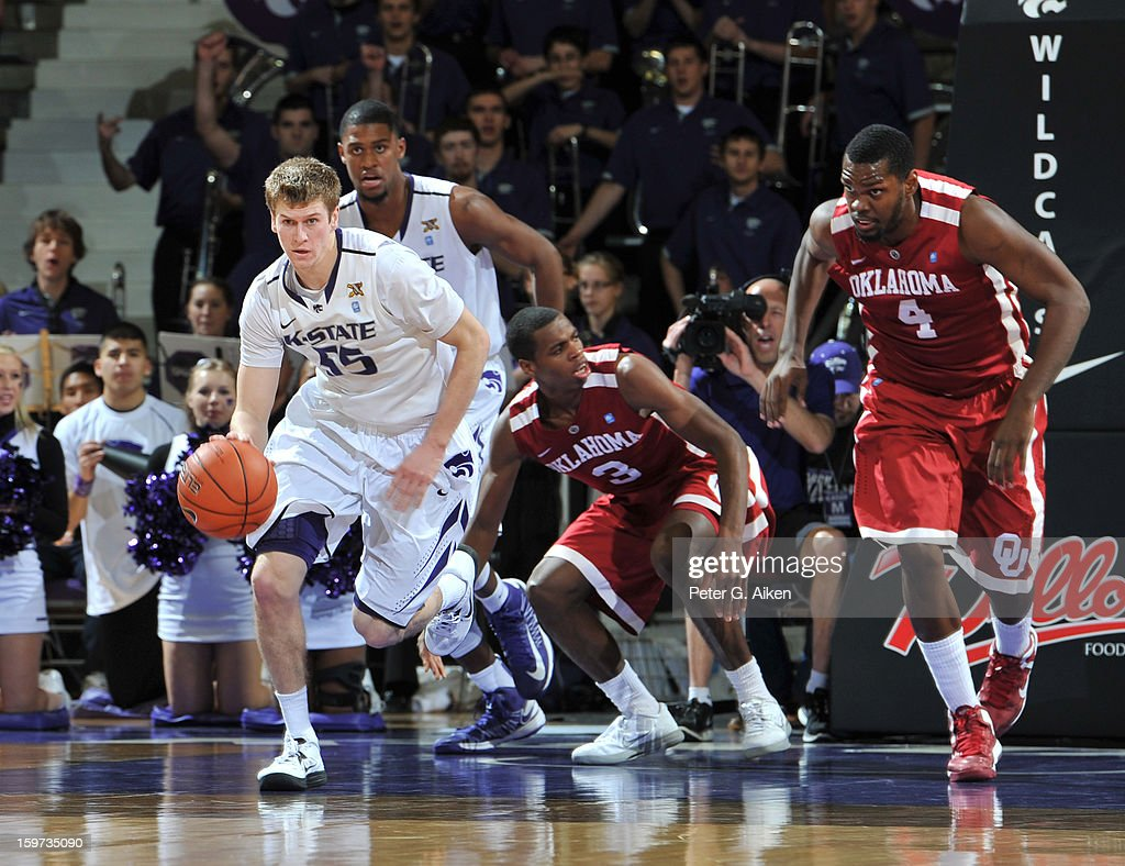 Guard Will Spradling #55 of the Kansas State Wildcats brings the ball up court after taking the ball away from Buddy Hield #3 of the Oklahoma Sooners during the second half on January 19, 2013 at Bramlage Coliseum in Manhattan, Kansas. Kansas State defeated Oklahoma 69-60.