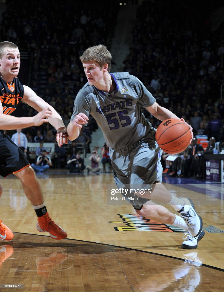 Guard Will Spradling #55 of the Kansas State Wildcats drives against guard Phil Forte #10 of the Oklahoma State Cowboys during the second half on January 5, 2013 at Bramlage Coliseum in Manhattan, Kansas.