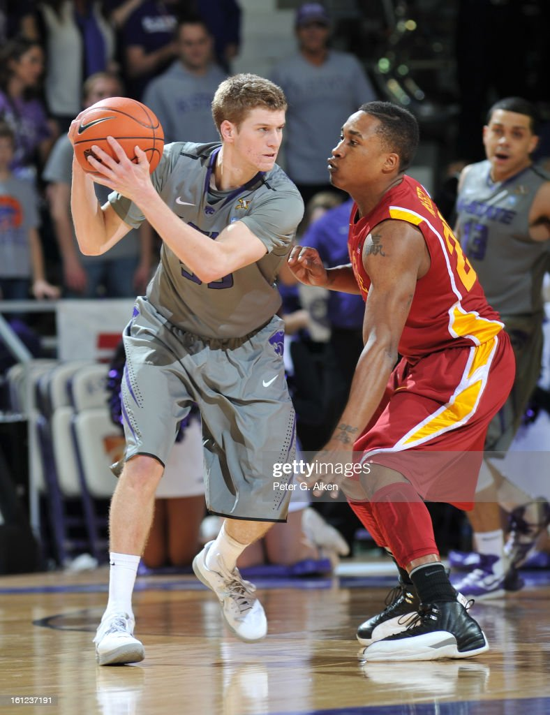 Guard Will Spradling #55 of the Kansas State Wildcats drives against guard Tyrus McGee #25 of the Iowa State Cyclones during the first half on February 9, 2013 at Bramlage Coliseum in Manhattan, Kansas. Kansas State defeated Iowa State 79-70.