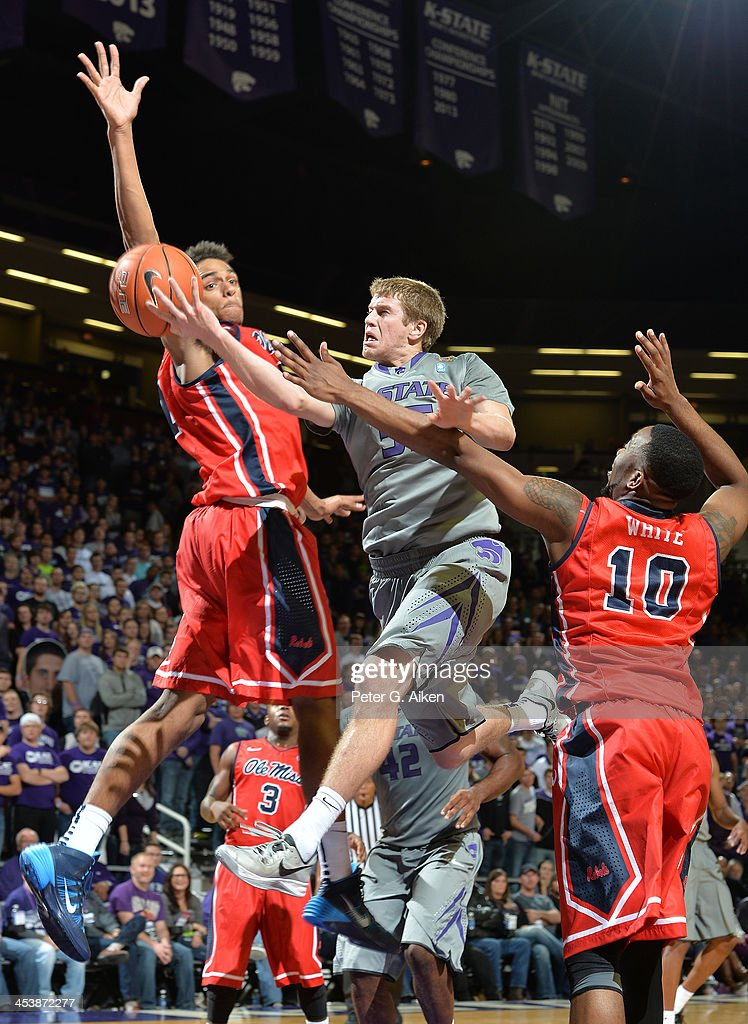 Guard Will Spradling #55 of the Kansas State Wildcats drives to the basket between defenders LaDarius White #10 and Anthony Perez #13 of the Mississippi Rebels during the second half on December 5, 2013 at Bramlage Coliseum in Manhattan, Kansas. Kansas State won 61-58.